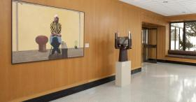 "Installation with ""Portrait of Manuel Izquierdo"" by George Johanson, 1977, and ""Moonblades,"" by Manuel Izquierdo, 1976."